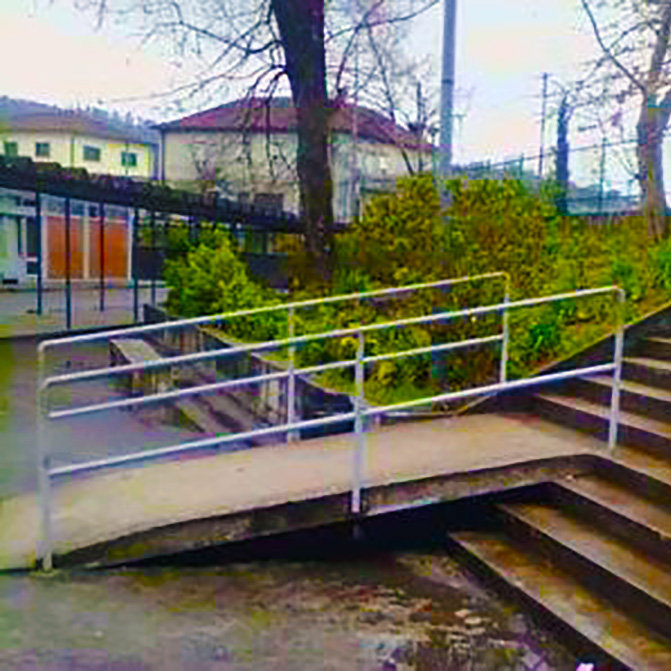 wheelchair ramp leads to set of stairs